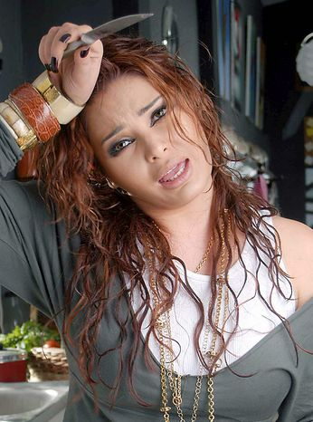 In this March 2008 file photo, Lebanese pop singer Suzanne Tamim poses during the filming of a video clip in Cairo, Egypt. In a case which has captivated the Arab public, an Egyptian court has handed billionaire tycoon Hisham Talaat Moustafa a lighter sentence of just 15 years after an earlier trial sentenced him to death for paying a retired Egyptian police officer to kill his popstar lover, Lebanese singer Suzanne Tamim, t was reported on Tuesday, Sept. 28, 2010. (AP Photo, File)
