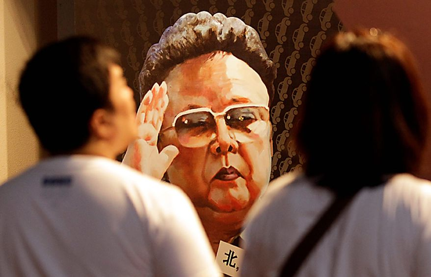 Tourists look at a painting of North Korean leader Kim Jong Il, painted by North Korean defector Sun Moo, at the Korea War Memorial Museum in Seoul,  South Korea, Tuesday, Sept. 28, 2010. North Korea's Kim Jong Il made his youngest son a four-star general, giving the 28-year-old his first known official title in a promotion seen Tuesday as confirmation that he is slated to become the country's next leader. (AP Photo/ Lee Jin-man)