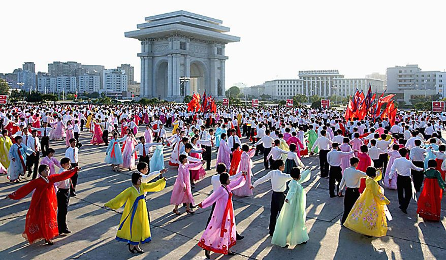 In this photo released by Korean Central News Agency via Korea News Service, North Korean youth dance to celebrate North Korean leader Kim Jong Il's re-election to the party's top position of general secretary in Workers' Party meeting in Pyongyang, North Korea, Tuesday, Sept. 28, 2010. (AP Photo/Korean Central News Agency via Korea News Service)