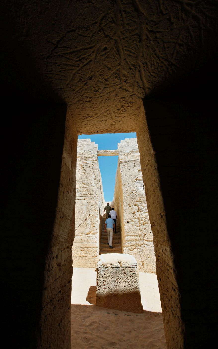 An altar is at the center of an open-air hall, part of a royal tomb at the site of ancient Leukaspis. Rich wheat and olive merchants built villas where modern Egyptians play in the sand. (Associated Press)
