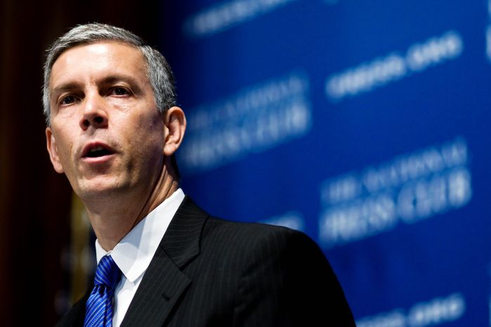 ** FILE ** Education Secretary Arne Duncan visited Friendship Collegiate Academy in Northeast on Wednesday to tout the federally funded Gaining Early Awareness and Readiness for Undergraduate Programs. (Associated Press)