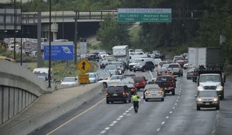 ASSOCIATED PRESS Emergency vehicles can be seen at the top left as traffic backs up at the scene of a commuter bus crash on Interstate 270, Wednesday, Sept. 29, 2010, in Bethesda, Md.