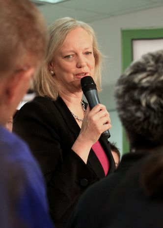California GOP gubernatorial candidate Meg Whitman discusses her campaign with workers at Altergy Systems after touring their fuel-cell manufacturing plant in Folsom, Calif., on Wednesday, Sept. 1, 2010. (AP Photo/Rich Pedroncelli)
