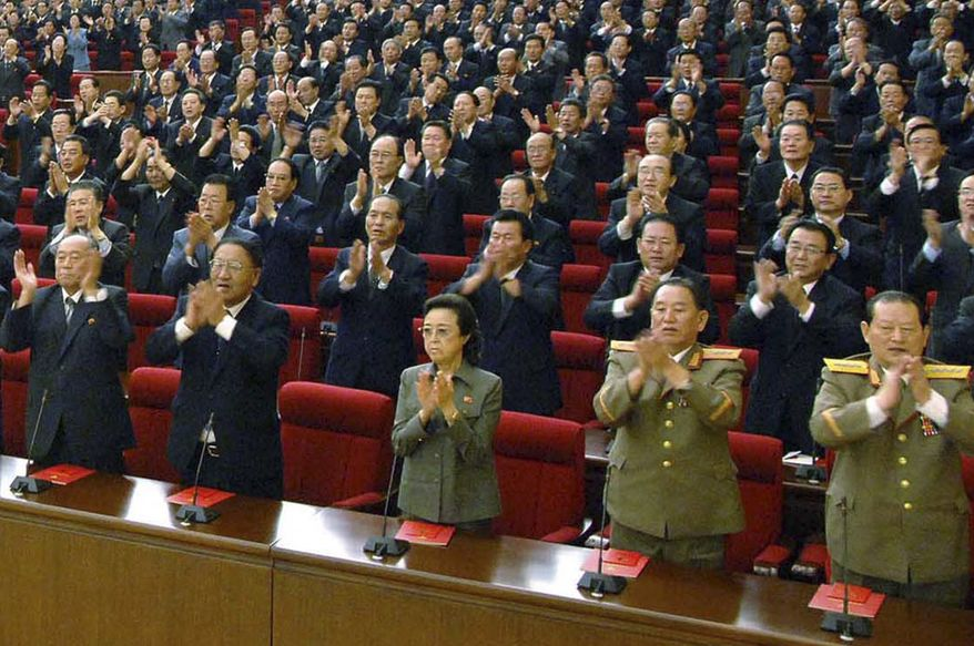 Delegates clap in unison during the ruling Workers' Party meeting in Pyongyang, North Korea, on Tuesday, Sept. 28, 2010. The Korean Central News Agency said Kim Kyong-hui (third from right in the front row), sister of North Korean leader Kim Jong-il, retained her position as a department director on the Central Committee and gained a new post as a member of the Central Committee's Political Bureau. (AP Photo/Korean Central News Agency via Korea News Service)