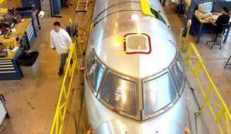 ** FILE ** Workers assemble regional jets at a Bombardier plant in Montreal in 2003. (Canadian Press Photo/Ryan Remiorz)