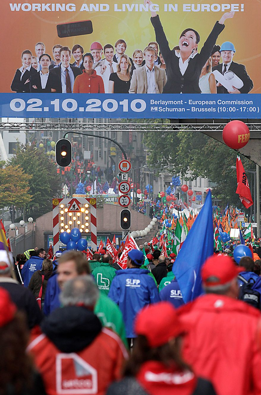 Demonstrators march down a main boulevard in Brussels Wednesday, Sept. 29, 2010. Labor unions prepared a march of nearly 100,000 workers on the European Union institutions on Wednesday to protest the budget slashing plans and austerity measures of governments seeking to control spiraling debt. (AP Photo/Yves Logghe)