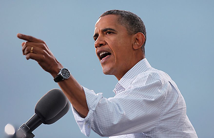 President Barack Obama speaks at a rally at the University of Wisconsin in Madison, Wis., Tuesday, Sept. 28, 2010. (AP Photo/Charles Dharapak)