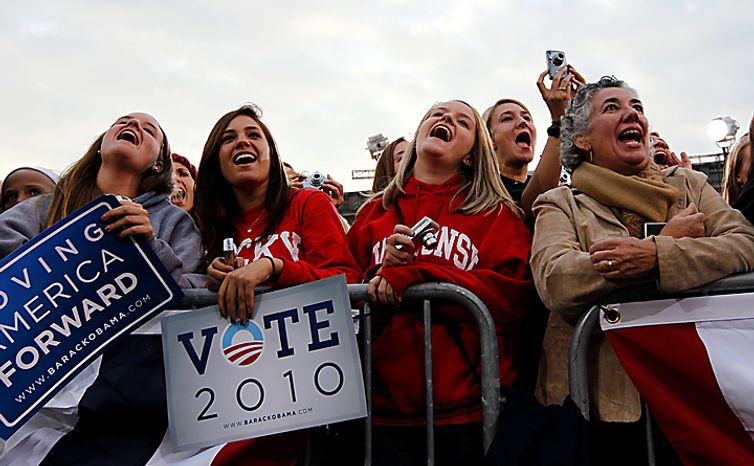 The crowd reacts as President Barack Obama speaks at a rally at the University of Wisconsin in Madison, Wis., Tuesday, Sept. 28, 2010. (AP Photo/Charles Dharapak)