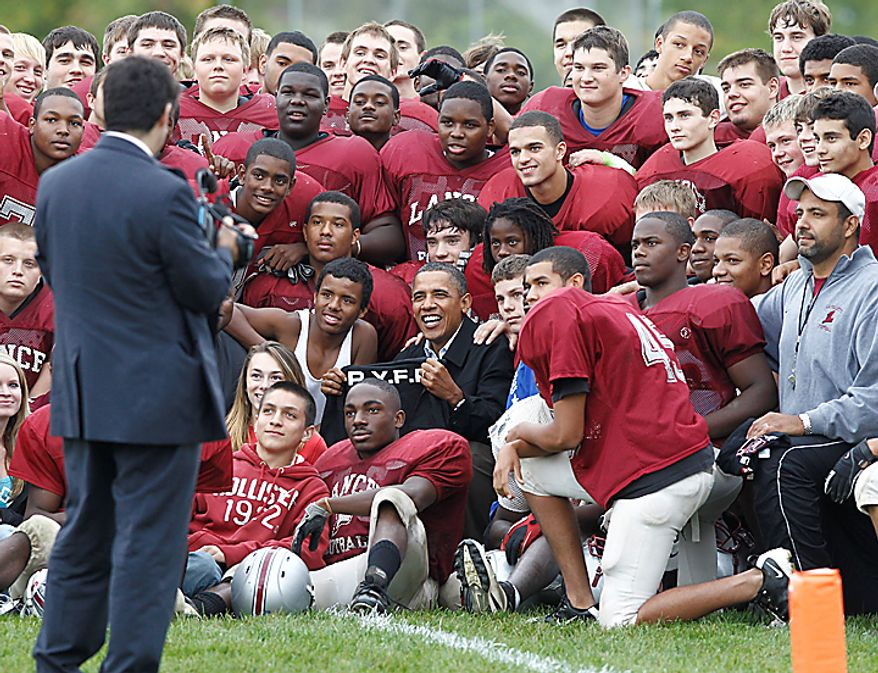 President Barack Obama makes an unscheduled stop and visits the La Follette High School Lancers football team in Madison, Wis., Tuesday, Sept. 28, 2010. (AP Photo/Charles Dharapak)