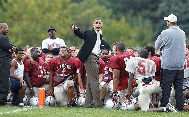President Obama makes an unscheduled stop to visit the La Follette High School Lancers football team in Madison, Wis., on Tuesday, Sept. 28, 2010. (AP Photo/Charles Dharapak)