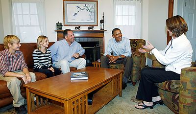 President Barack Obama meets with Jeff and Sandy Clubb and their children Tristan, 11, and Skyelar, 9, at their home in Des Moines, Iowa, Wednesday, Sept. 29, 2010, before holding a discussion with neighborhood families in their backyard.  (AP Photo/Charles Dharapak)