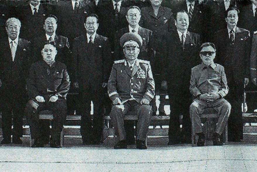 The front page of North Korea's Rodong Sinmun newspaper of Thursday, Sept. 30, 2010, shows North Korean leader Kim Jong-il, seated right, posing with senior Workers' Party officials in Pyongyang, North Korea. The newspaper identified the man seated at left as Kim Jong-un, the third son of Kim Jon-iI. The man at center is Vice Marshal Ri Yong-ho. (AP Photo)