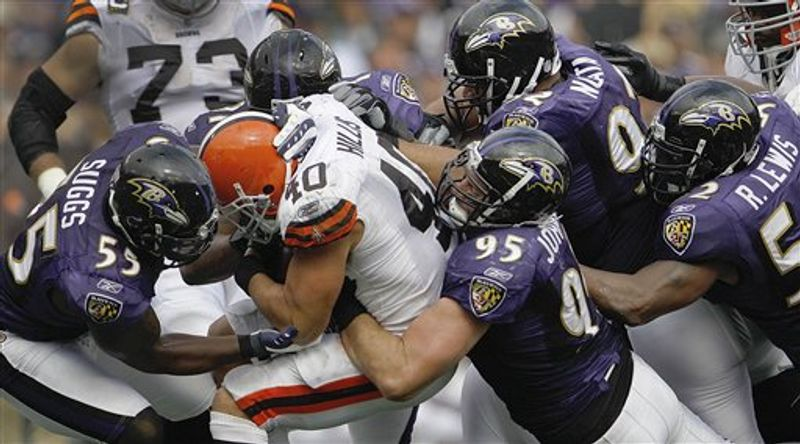 Cleveland Browns running back Peyton Hillis is stopped by Baltimore Ravens linebacker Terrell Suggs, linebacker Jarret Johnson, defensive tackle Haloti Ngata and linebacker Ray Lewis during the second half of an NFL football game in Baltimore, on Sunday, Sept. 26, 2010. (AP Photo/Evan Vucci)