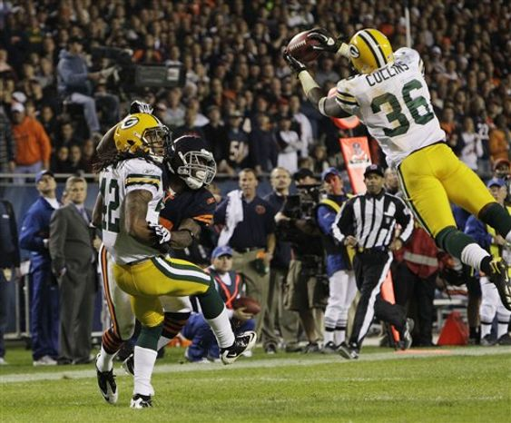 Green Bay Packers quarterback Aaron Rodgers (12) dives into the corner of the end zone for a touchdown against the Chicago Bears during the second half of an NFL football game Monday, Sept. 27, 2010, in Chicago. The Packers lost 20-17. (AP Photo/Morry Gash)