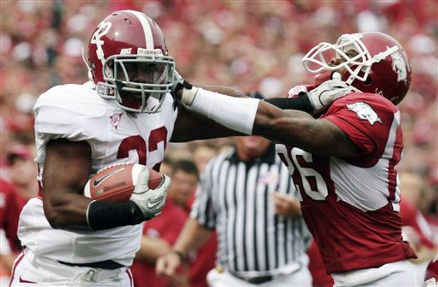 FILE - In this Sept. 18, 2010, file phot, Alabama running back Mark Ingram (22) carries the ball during the first quarter of an NCAA college football game against Duke in Durham, N.C. (AP Photo/Sara D. Davis, File)