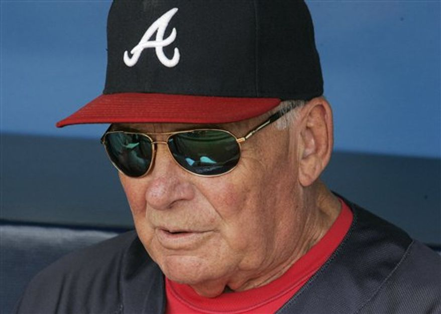 In this photo taken Monday, Sept. 27, 2010, Atlanta Braves manager Bobby Cox looks on during a baseball game against the  Florida Marlins at Turner Field, in Atlanta. Atlanta leads the race for the NL wild-card berth and Cox said another playoff run would be the perfect sendoff in his final season as manager. During his quarter-century with the Braves he led them to a run of 14 straight division titles beginning in 1991, including the 1995 World Series title. (AP Photo/John Amis)