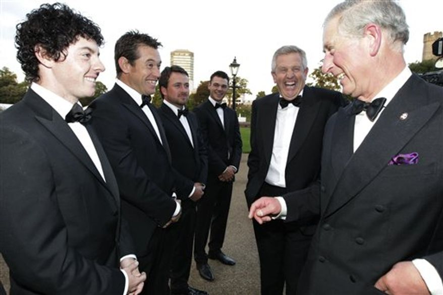 Britain's Prince Charles, the Prince of Wales, right,  is introduced to players from the European Ryder Cup team (left to right) Rory McIlroy,  Lee Westwood, Graeme McDowell, and Martin Kaymer by team captain Colin Montgomerie, 2nd right,  at the at the Welcome to Wales 2010 Ryder Cup dinner at Cardiff Castle, Cardiff, Wales,  Wednesday,  Sept. 29, 2010. The long-anticipated golf event tees off on Friday.  (AP Photo /  Heathcliff O'Malley,  Pool)