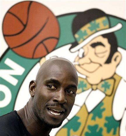 Boston Celtics' Kevin Garnett does a radio interview during media day at the team's NBA basketball training camp in Waltham, Mass., Monday, Sept. 27, 2010.   (AP Photo/Winslow Townson)