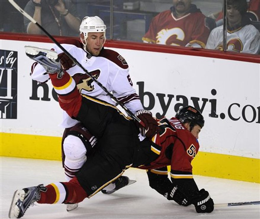 Calgary Flames' Jarome Iginla, left, celebrates his goal against the Phoenix Coyotes with Olli Jokinen, from Finland, during the first period of an NHL preseason hockey game Tuesday, Sept. 28, 2010, in Calgary, Alberta. (AP Photo/The Canadian Press, Larry MacDougal)