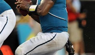 Jacksonville Jaguars quarterback David Garrard (9), right, is sacked by Philadelphia Eagles defensive tackle Trevor Laws (93) during the first half of an NFL football game in Jacksonville, Fla., Sunday, Sept. 26, 2010. (AP Photo/Phelan M. Ebenhack)