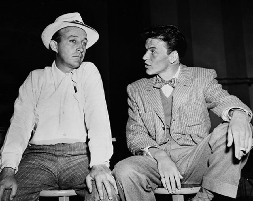 FILE - In this Nov. 13, 1944, file photo Bing Crosby, left, and Frank Sinatra, right, appear together in New York City, as they discuss upcoming appearances on each others' radio shows. The nation's first comprehensive study of the preservation of sound recordings in the United States shows new digital audio recordings are at greater risk of being lost than older recordings. The study also found major parts of the nation's heritage in recorded sound already have been lost or can't be accessed by the public.(AP Photo)