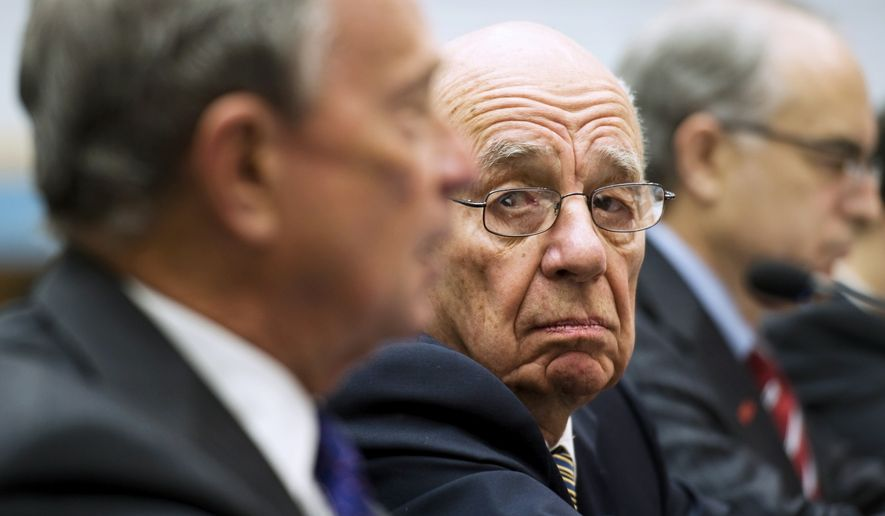 News Corp. Chairman and CEO Rupert Murdoch, center, looks toward New York Mayor Michael Bloomberg, as they testify on Capitol Hill Washington, Thursday, Sept. 30, 2010, before the House Immigration, Citizenship, Refugee, Border Security, and International Law subcommittee hearing on the role of immigration in strengthening America's economy. (AP Photo/Cliff Owen)