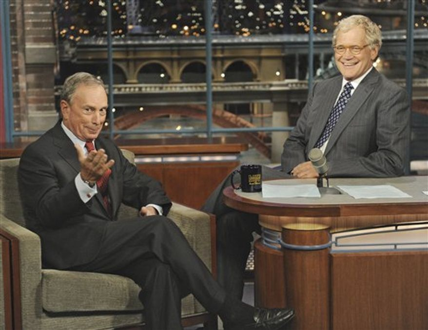 """In this photo released by CBS, New York City Mayor Michael Bloomberg, left, shares a laugh with host David Letterman on the set of the """"Late Show with David Letterman,"""" in New York, Wednesday, Sept. 29, 2010. (AP Photo/CBS, John Paul Filo)"""