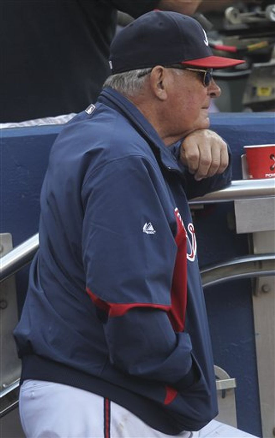 Atlanta Braves manager Bobby Cox jogs back to the dugout after making a pitching change during a baseball game against the Florida Marlins, Wednesday, Sept. 29, 2010 in Atlanta. Cox plans to retire after the season. (AP Photo/John Bazemore)