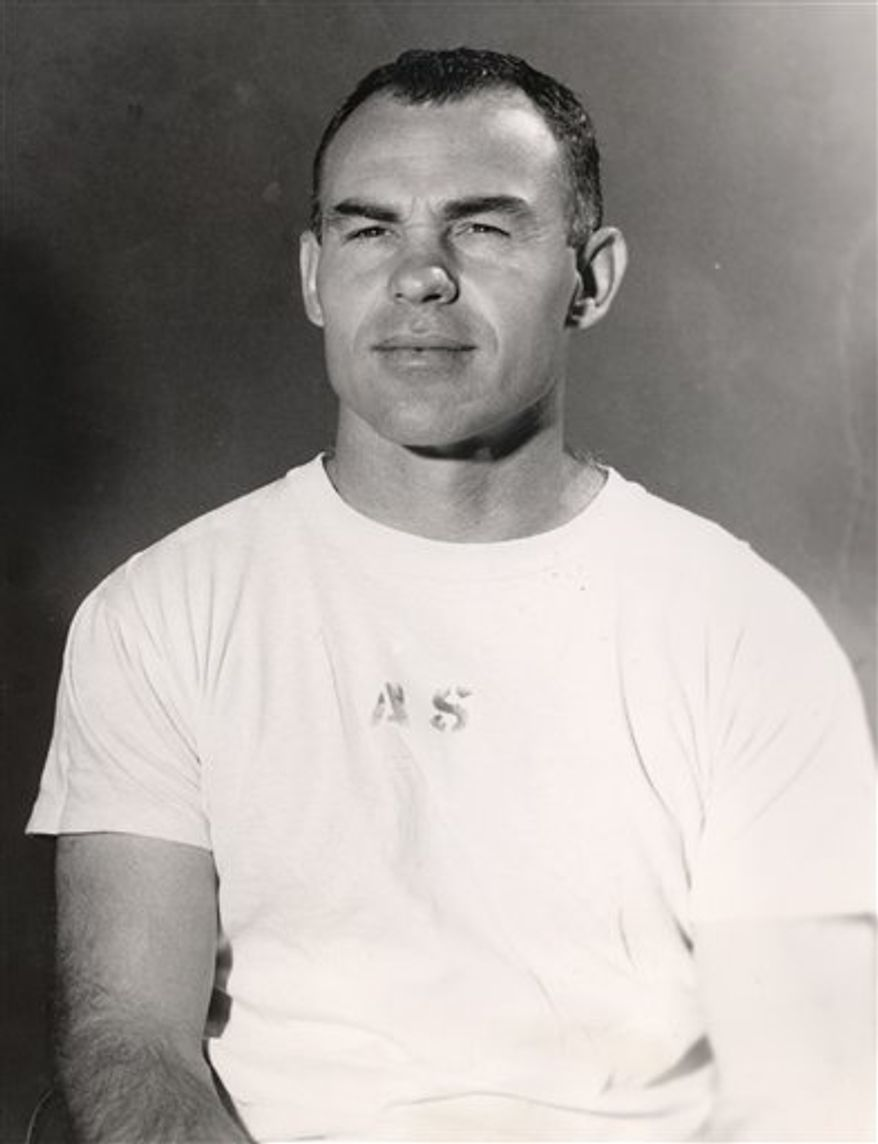 FILE - In a 1959 file photo provided by the University of Notre Dame, Don Doll, then a backfield coach with the Notre Dame football team, poses for a photo. Doll, a standout defensive back who was part of the Detroit Lions' 1952 NFL championship team, has died. He was 84. The Lions say Doll died Wednesday, Sept. 22, 2010, in San Juan Capistrano, Calif. (AP Photo/University of Notre Dame, File)