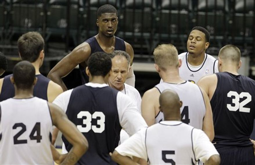 Indiana Pacers head coach Jim O'Brien talks to the team following a NBA team practice in Indianapolis, Tuesday, Sept. 28, 2010. (AP Photo/Darron Cummings)