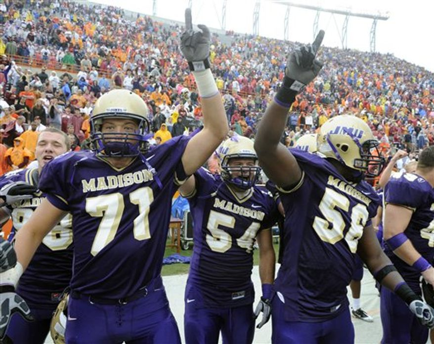 FILE - in this Sept. 11, 2010, file photo, James Madison players, from left, Josh Wells, Chad Byers, and Jordon Stanton celebrate after defeating 13th ranked Virginia Tech 21-16 in a NCAA football game at Lane Stadium in Blacksburg, Va. Any time a team from what used to be I-AA, such as James Madison, pulls off an Appalachian State-style upset it causes a stir. But this one was especially significant because of the long-term effect it could have on Boise State's BCS run. (AP Photo/Don Petersen, File)
