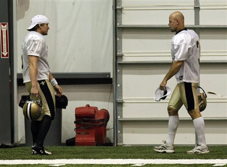 New Orleans Saints place kicker Garrett Hartley, left, and newly-signed veteran kicker John Carney (3) greet each other during the start of workouts at  their NFL football training facility in Metairie, La., Wednesday, Sept. 29, 2010. (AP Photo/Gerald Herbert)