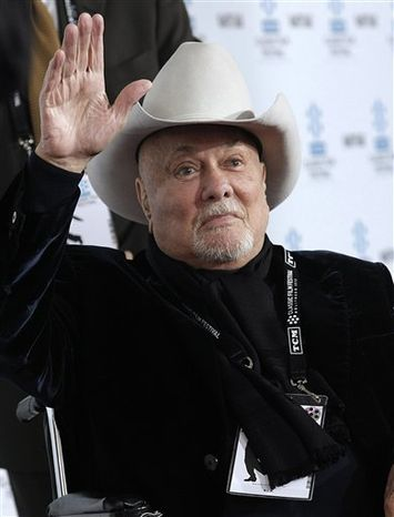 """FILE - In an April 22, 2010 file photo Tony Curtis arrives at the premiere of the newly restored feature film """"A Star Is Born"""" in Los Angeles. Curtis has died at 85 according to the Clark County, Nev. coroner. (AP Photo/Dan Steinberg/file)"""