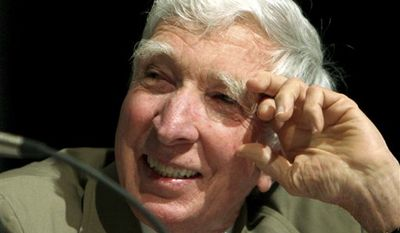 "FILE - In this May 20, 2006 file photo, author John Updike speaks at BookExpo America 2006 in Washington.  Pennsylvania's Alvernia University announced Wednesday, Sept. 29, 2010 that it will house the scholarly archives of The John Updike Society. The organization studies the life and work of John Updike, the acclaimed chronicler of American suburbia whose more than 60 books include ""Rabbit, Run."" (AP Photo/Caleb Jones, File)"