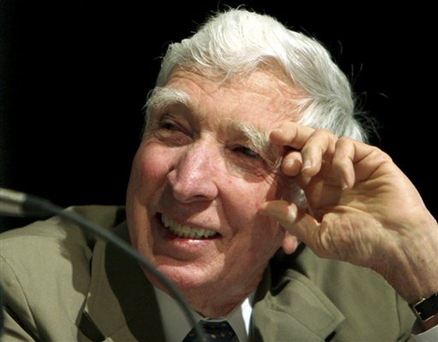 """FILE - In this May 20, 2006 file photo, author John Updike speaks at BookExpo America 2006 in Washington.  Pennsylvania's Alvernia University announced Wednesday, Sept. 29, 2010 that it will house the scholarly archives of The John Updike Society. The organization studies the life and work of John Updike, the acclaimed chronicler of American suburbia whose more than 60 books include """"Rabbit, Run."""" (AP Photo/Caleb Jones, File)"""