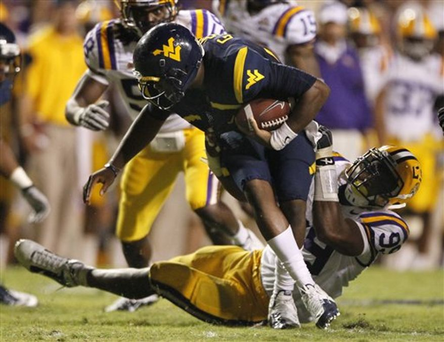 LSU cornerback Patrick Peterson (7) imitates a Heisman Trophy pose after scoring a touchdown against West Virginia during the first half of an NCAA college football game in Baton Rouge, La., Saturday, Sept. 25, 2010. (AP Photo/Patrick Semansky)