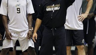 ** FILE ** Washington Wizards coach Flip Saunders, center, works drills with the team including Gilbert Arenas, left, and Sean Marks, right, during NBA basketball training camp at the Patriot Center at George Mason University in Fairfax, Va., Wednesday, Sept. 29, 2010. (AP Photo/Carolyn Kaster)