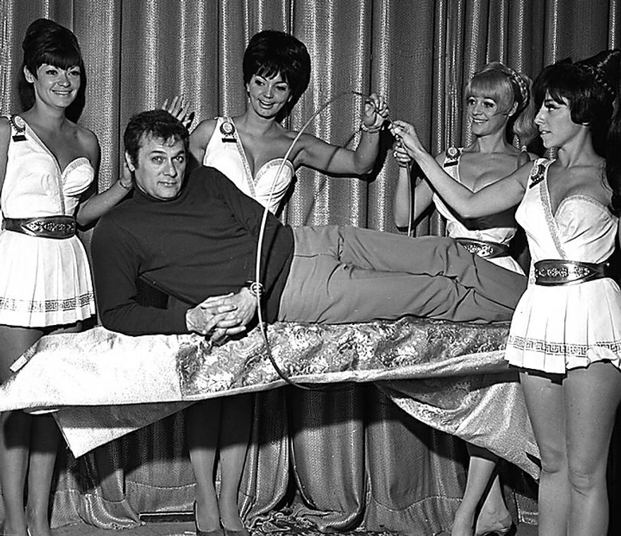 """This Nov. 2, 1967 photo provided by the Las Vegas News Bureau shows Tony Curtis starring in """"Hollywood Palace"""", a weekly variety show, at Caesars Palace in Las Vegas.  Curtis, died of cardiac arrest Wednesday Sept. 29, 2010 at his Las Vegas area home. He was 85. (AP Photo/Las Vegas News Bureau)"""