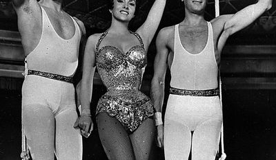 """Burt Lancaster, Gina Lollobrigida and Tony Curtis, right, appear in a scene from the 1956 film """"Trapeze,"""" which premiered in Beverly Hills, Calif. Curtis has died at 85 according to the Clark County, Nev. coroner.(AP Photo/Files)"""