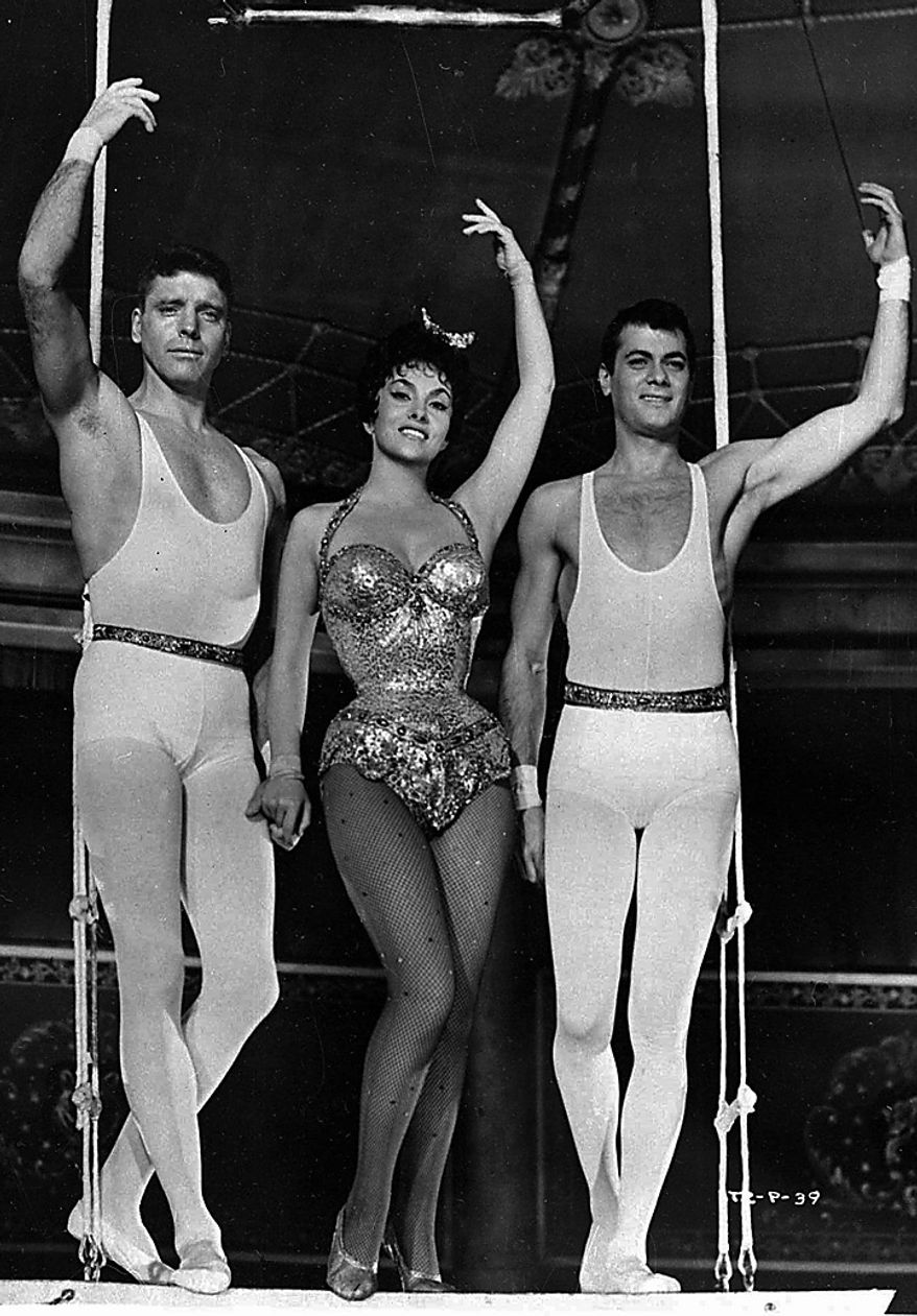"Burt Lancaster, Gina Lollobrigida and Tony Curtis, right, appear in a scene from the 1956 film ""Trapeze,"" which premiered in Beverly Hills, Calif. Curtis has died at 85 according to the Clark County, Nev. coroner.(AP Photo/Files)"