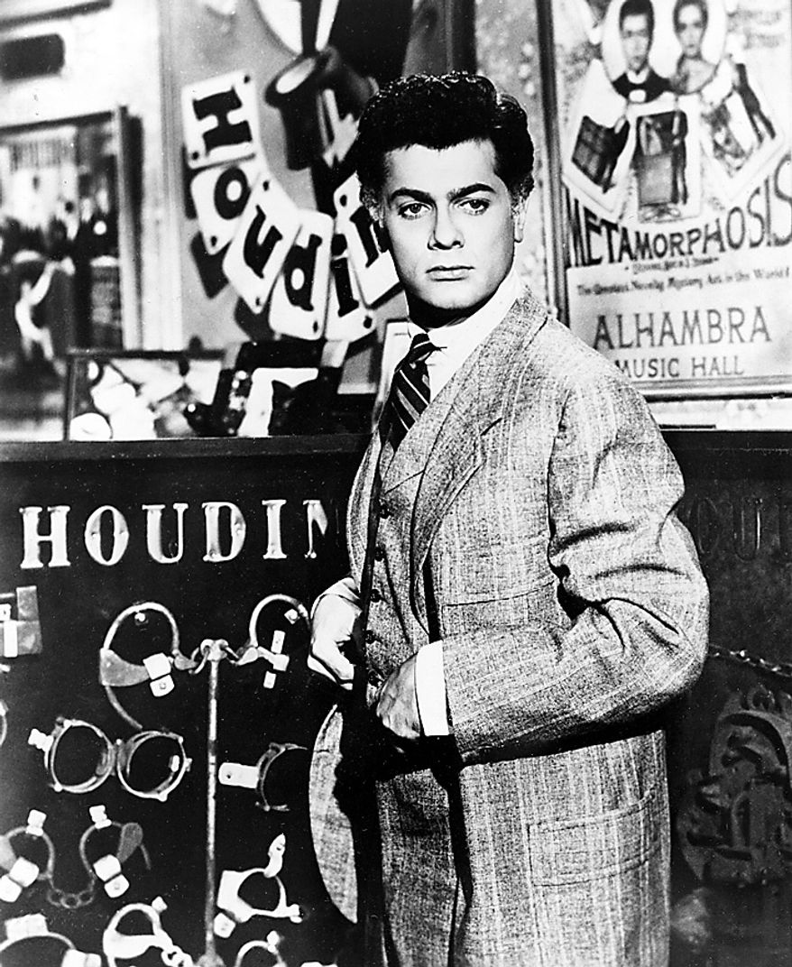 """Actor Tony Curtis portrays magician Harry Houdini in the 1953 Hollywood movie """"Houdini."""" Curtis has died at 85 according to the Clark County, Nev. coroner.  (AP Photo, File)"""