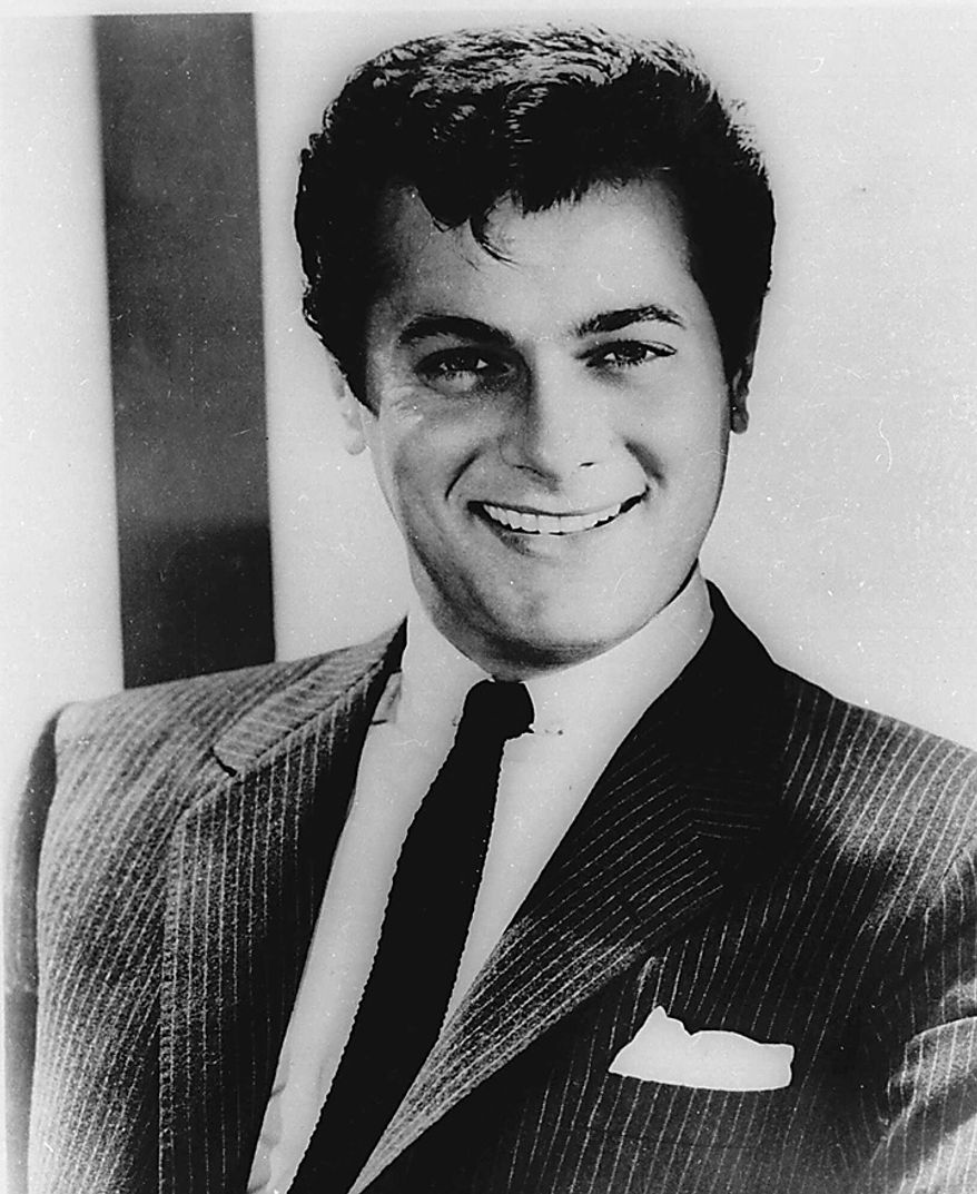 Tony Curtis poses in this April 1959 file photo. Curtis died Wednesday Sept. 29, 2010 at his Las Vegas area home of a cardiac arrest at 85 according to the Clark County, Nev. coroner. (AP Photo, File)