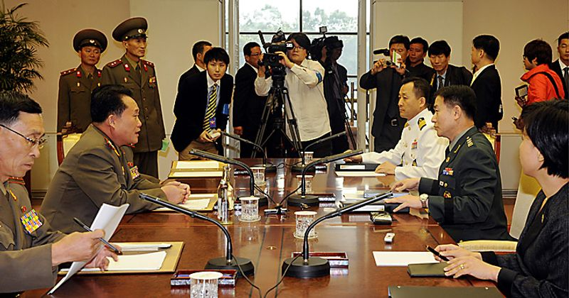 South Korean delegate Army Col. Moon Sang-gyun, sitting right center, talks with North Korean counterpart Col. Ri Shin Kwon, sitting second left, during a military meeting at the south side of the truce village of Panmunjom in the demilitarized zone (DMZ) that separates the two Koreas since the Korean War, north of Seoul, South Korea, Thursday, Sept. 30, 2010. North and South Korea ended their first working-level military talks in two years Thursday with no progress as the meeting stumbled over the deadly sinking of a South Korean warship blamed on Pyongyang, Seoul's Defense Ministry said. (AP Photo/ Korea Pool)