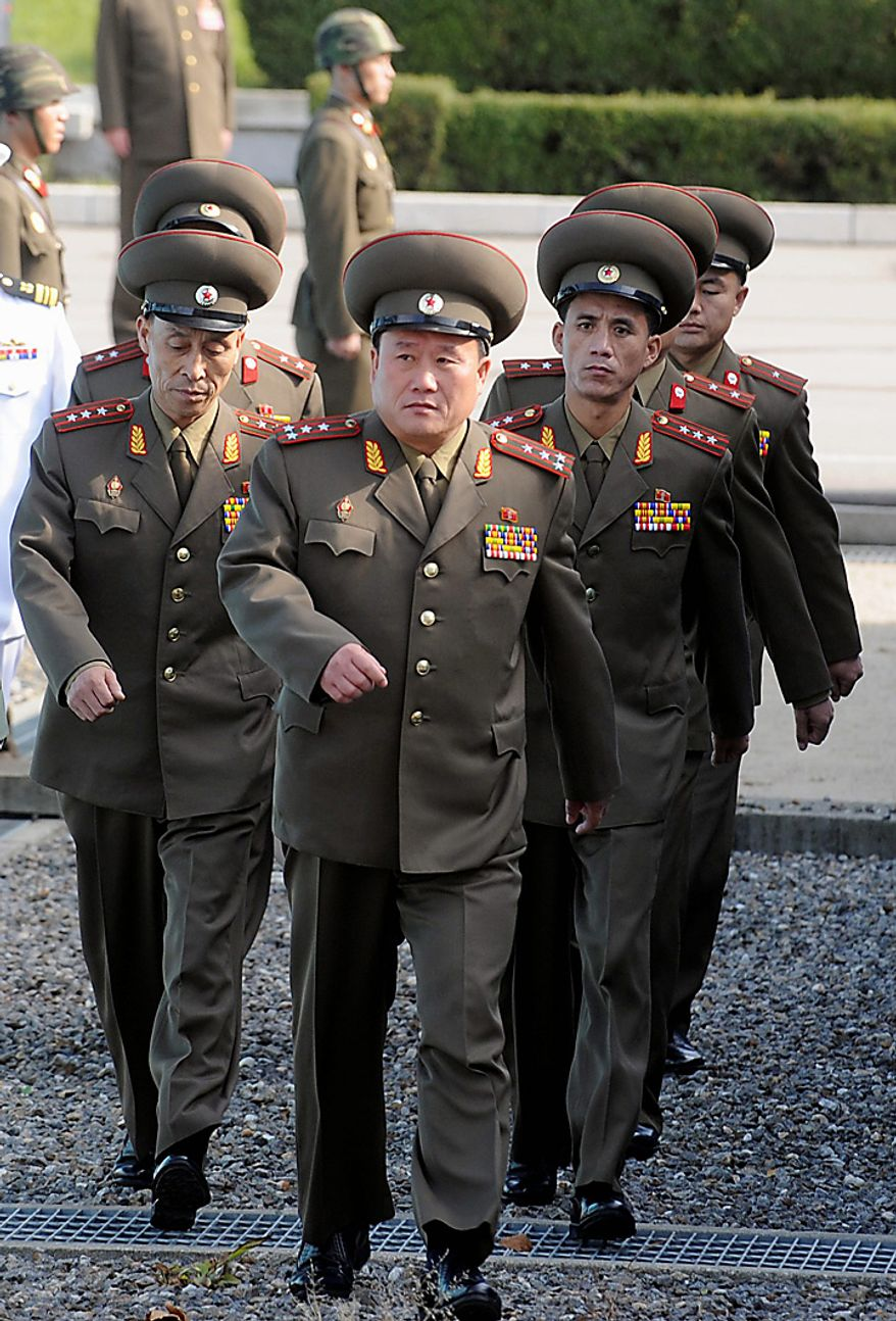 Head of North Korean delegate Col. Ri Shin Kwon, center, and others cross the border line for a military meeting at the south side of the truce village of Panmunjom in the demilitarized zone (DMZ) that separates the two Koreas since the Korean War, north of Seoul, South Korea, Thursday, Sept. 30, 2010. North and South Korea ended their first working-level military talks in two years Thursday with no progress as the meeting stumbled over the deadly sinking of a South Korean warship blamed on Pyongyang, Seoul's Defense Ministry said. (AP Photo/ Korea Pool)