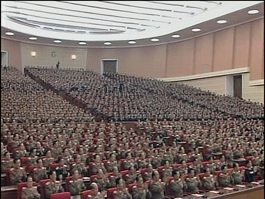 In this Tuesday, Sept. 28, 2010 image made from KRT video distributed by APTN Thursday, Sept. 30, 2010, participants to the North Korean ruling Workers' Party representatives meeting clap hands during the biggest gathering in 30 years to elect new leaders in Pyongyang, North Korea. (AP Photo/KRT/APTN)