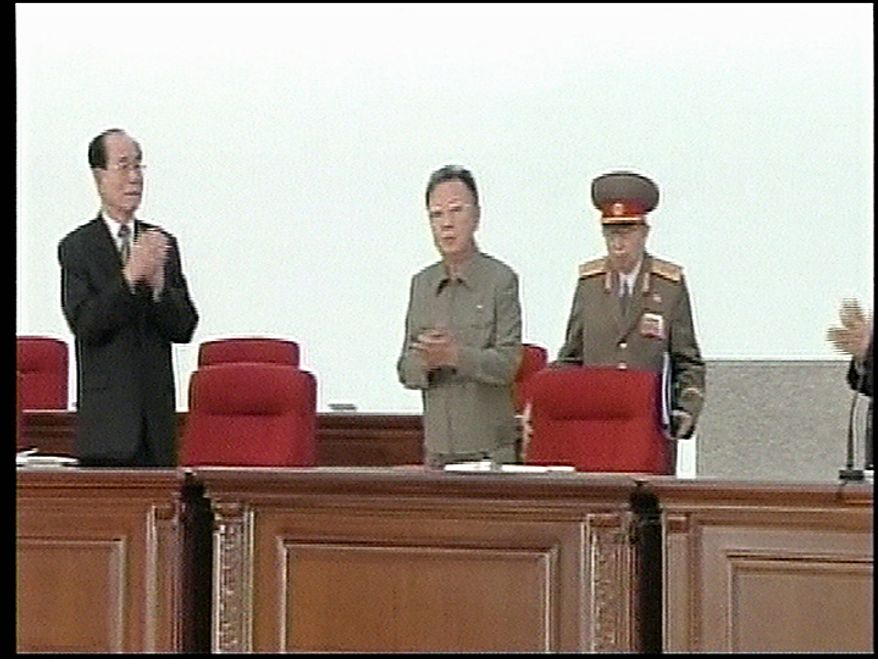 In this Tuesday, Sept. 28, 2010 image made from KRT video distributed by APTN Thursday, Sept. 30, 2010, North Korean leader Kim Jong Il, center, arrives at North Korean ruling Workers' Party representatives meeting as North's No. 2 official Kim Yong Nam, left, and other participants applaud during the biggest political gathering in 30 years to elect new leaders in Pyongyang, North Korea. (AP Photo/KRT/APTN)