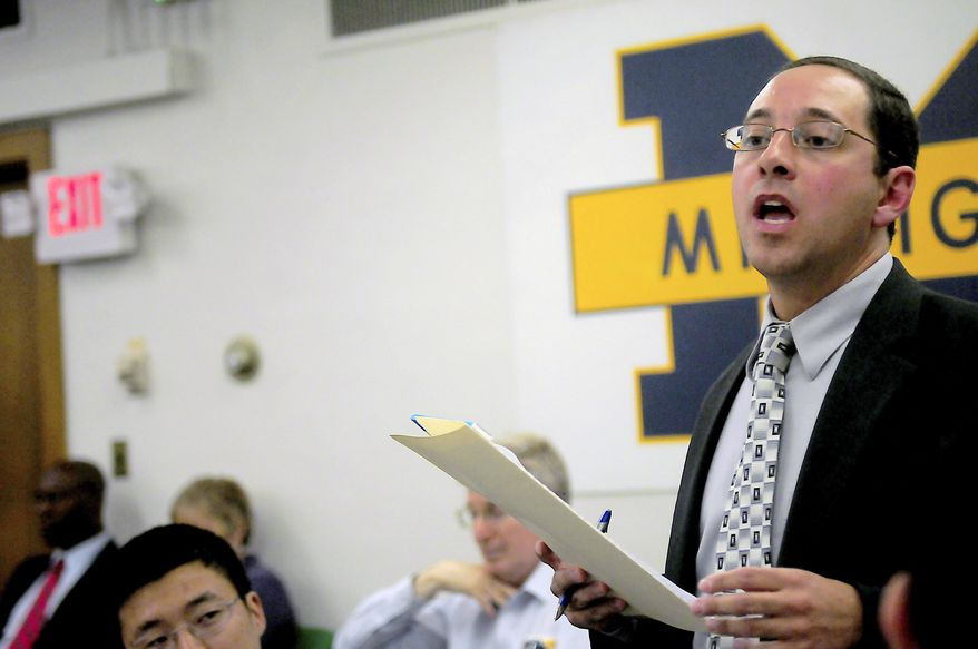 In this Sept. 7, 2010, photo, University of Michigan alumnus and assistant attorney general Andrew Shirvell speaks about the University of Michigan's student assembly president Chris Armstrong at a Michigan Student Assembly meeting in Ann Arbor, Mich. (AP Photo/The Michigan Daily, Marissa McClain)
