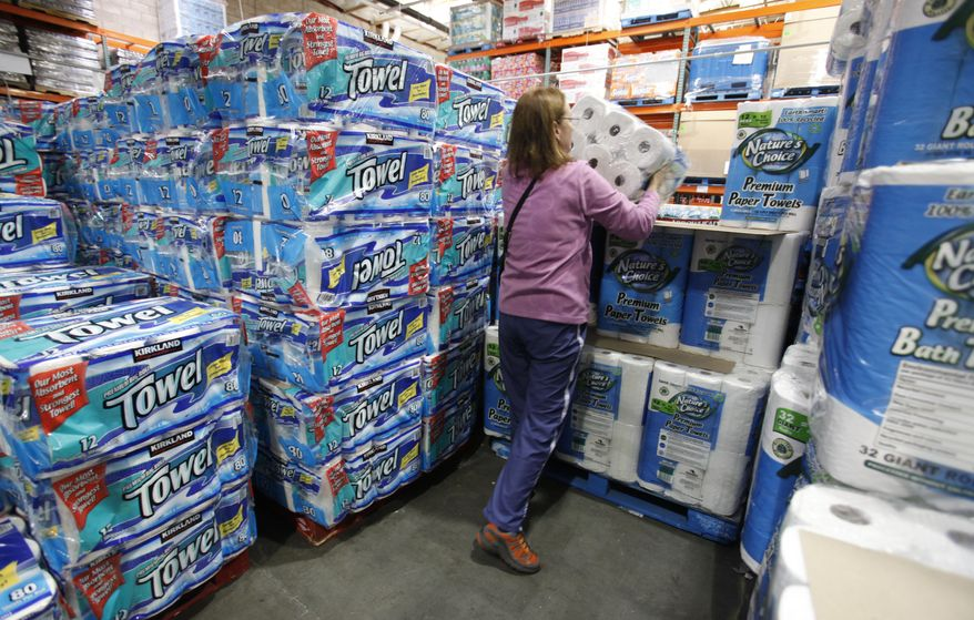 In this Sept. 8, 2010, photo, a shopper buys paper towels at Costco in Mountain View, Calif. Consumer spending rose by a moderate amount in August while incomes increased by the largest amount in eight months, a gain that was propelled by the resumption of extended unemployment benefits. (AP Photo/Paul Sakuma)