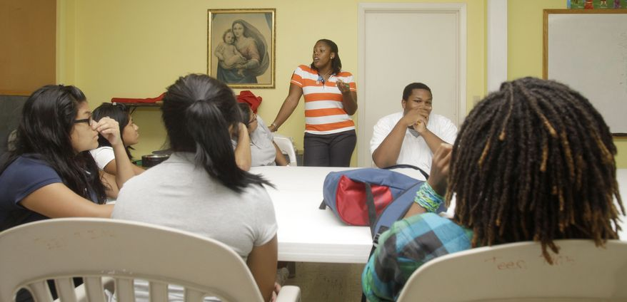 **FILE** Sex education teacher Shayna Knowles (center) talks Sept. 10, 2010, to students during class at St. Andrew's Episcopal Church in Lake Worth, Fla. (Associated Press)