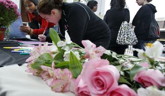 Rutgers University students sign condolence cards Friday, Oct. 1, 2010, in New Brunswick, N.J., for the family of fellow student Tyler Clementi, who committed suicide apparently after his roommate allegedly broadcast video of his having sex with another man. (AP Photo/Mel Evans)